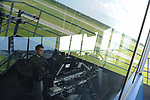 Second Lieutenant Robert Huul, an airman with Estonia's Air Force, monitors air traffic from the control tower as part of NATO's Baltic Air Policing mission at Ämari Air Force Base, Estonia on June 7, 2019.