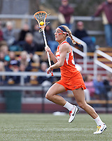 Syracuse University defender Becca Block (33) on the attack.   Syracuse University (orange) defeated Boston College (white), 17-12, on the Newton Campus Lacrosse Field at Boston College, on March 27, 2013.