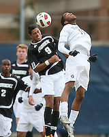 Chandler Diggs #14 of Georgetown University heads over Marc Cintron #9 of Providence University during a Big East quarter-final  match at North Kehoe Field, Georgetown University on November 6 2010 in Washington D.C. Providence won 2-1.
