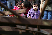 Pictured: Young children as seen through the remains of the crashed down gates at the Athens Polytechinc in Athens Greece. Wednesday 16 November 2016<br /> Re: 43rd anniversary of the Athens Polytechnic uprising of 1973 which was a massive demonstration of popular rejection of the Greek military junta of 1967–1974. The uprising began on November 14, 1973, escalated to an open anti-junta revolt and ended in bloodshed in the early morning of November 17 after a series of events starting with a tank crashing through the gates of the Polytechnic.