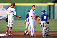 Greg Garcia (7) and Kolten Wong (4) of the Springfield Cardinals greet young ball players prior to a game against the Arkansas Travelers at Hammons Field on June 12, 2012 in Springfield, Missouri. (David Welker/Four Seam Images)