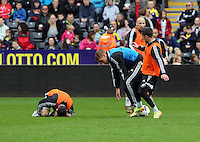 Wednesday, 23 April 2014<br /> Pictured: Leon Britton (L) suffers a minor injury during training.<br /> Re: Swansea City FC are holding an open training session for their supporters at the Liberty Stadium, south Wales,
