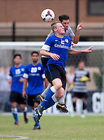 Tyler Rudy (13) of Georgetown goes up for a header with Fabian Herbers (2) of Creighton during the game at Shaw Field on the campus of the Georgetown University in Washington, DC.  Georgetown tied Creighton, 0-0, in double overtime.