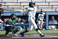 Michigan Wolverines outfielder Christian Bullock (5) follows through on his swing against the Michigan State Spartans on March 21, 2021 in NCAA baseball action at Ray Fisher Stadium in Ann Arbor, Michigan. Michigan scored 8 runs in the bottom of the ninth inning to defeat the Spartans 8-7. (Andrew Woolley/Four Seam Images)