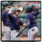 Erik Ostberg (21) of the Bowling Green Hot Rods celebrates a home run in a game against the Greenville Drive on Sunday, May 9, 2021, at Fluor Field at the West End in Greenville, South Carolina. (Tom Priddy/Four Seam Images)