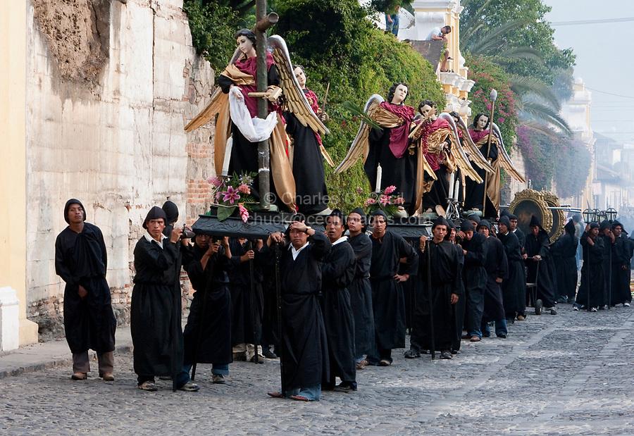 Antigua, Guatemala.  Holy Saturday.  Men Pausing to Rest in the Procession of the Virgin of Solitude (Virgen de Soledad), Holy Week, La Semana Santa.