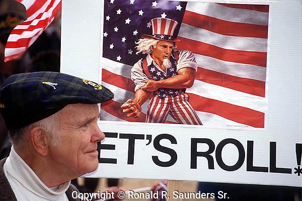 ELDERLY GENTLEMEN AND PRO WAR SIGN AT IRAQ WAR RALLY DENVER