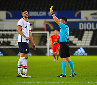 12th November 2020; Liberty Stadium, Swansea, Glamorgan, Wales; International Football Friendly; Wales versus United States of America; Matt Miazga of USA receives a Yellow card from Referee Nick Walsh