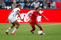 Ashley Lawerance #10 of Canada turns with the ball