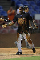 Winston-Salem shortstop Victor Mercedes is covered in dirt from head to toe after having slide into second, third and home to score versus the Frederick Keys at Ernie Shore Field in Winston-Salem, NC, Friday, August 4, 2006.  The Warthogs defeated the Keys 3-1.