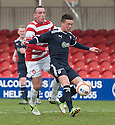 Raith's Joe Cardle holds off Accies Darian MacKinnon.