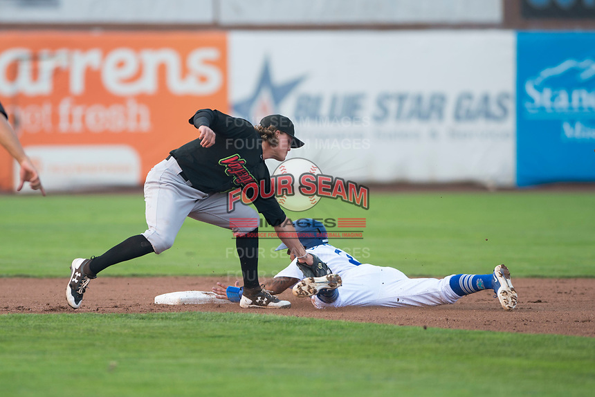 Great Falls Voyagers shortstop Travis Moniot (16) applies a late tag to Kenneth Betancourt (9) as he slides into second base on a stolen base attempt during a Pioneer League against the Ogden Raptors at Lindquist Field on August 23, 2018 in Ogden, Utah. The Ogden Raptors defeated the Great Falls Voyagers by a score of 8-7. (Zachary Lucy/Four Seam Images)