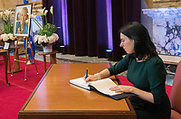 Montreal Mayor Valerie Plante signs a book of condolences during a memorial service for Lise Payette at City Hall in Montreal, Saturday, October 20,, 2018. THE CANADIAN PRESS/Graham Hughes