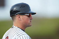 Kannapolis Intimidators manager Justin Jirschele (9) coaches third base during the game against the Lakewood BlueClaws at Kannapolis Intimidators Stadium on April 8, 2018 in Kannapolis, North Carolina.  The Intimidators defeated the BlueClaws 4-3 in game two of a double-header.  (Brian Westerholt/Four Seam Images)