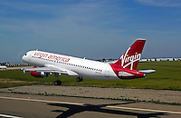aerial photograph of N628VA, Virgin America Airlines Airbus A320-214 on takeoff at the Stockton Metropolitan Airport, California