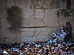 Jewish worshipers pray at the wailing wall Judaism most Holy site in Jerusalem Thursday April 17 2014. Thousands of Jewish worshipers gathered in Jerusalem to take part in  the tri-annual blessing of the Jewish people by members of the Jewish priestly caste at the Wailing Wall in Jerusalem. Jews named Cohen, considered descendants of the Temple's high priest, have the special duty of blessing the congregation three times a year.  Photo by Eyal Warshavsky