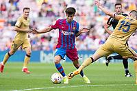 26th September 2021;   Nou Camp, Barcelona, Spain: La Liga football, FC Barcelona versus Levante: Riqui Puig Barcelona skips the challenge from Postigo