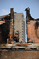 The Delta hotel is seen through the Manege Militaire de Quebec (Quebec city armory) ruins on avenue Wilfrid-Laurier April 7, 2008. The fire completely destroyed on April 4 the Manege militaire, an important piece of the Canadian military history built in 1885.