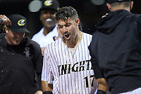 Danny Mendick (17) of the Charlotte Knights is doused with water by his teammates after hitting a walk-off 3-run home run in the bottom of the 10th inning against the Toledo Mud Hens at BB&T BallPark on April 23, 2019 in Charlotte, North Carolina. The Knights defeated the Mud Hens 11-9 in 10 innings. (Brian Westerholt/Four Seam Images)