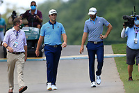 4th September 2020, Atlanta GA, USA;  John Rahm (l) and Dustin Johnson (r) approach the first tee box during the first round of the TOUR Championship  at the East Lake Golf Club in Atlanta, GA.
