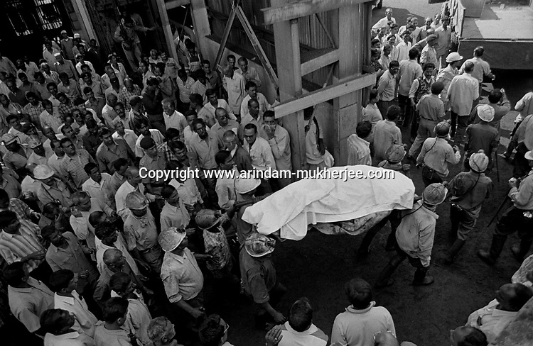 Coal miners bringing out the dead body of M.K. Sing, a mining sardar at Moonidih colliery after a mine accident, Jharia, Jharkhand, India. Arindam Mukherjee