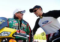 May 4, 2012; Commerce, GA, USA: NHRA funny car driver John Force (left) with Bob Tasca III during qualifying for the Southern Nationals at Atlanta Dragway. Mandatory Credit: Mark J. Rebilas-