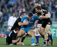 Rugby: test match Italia vs Nuova Zelanda. Roma, stadio Olimpico, 17 novembre 2012..Italy's Giovanbattista Venditti, center, is challenged by New Zealand's players their international rugby test match at Rome's Olympic stadium, 17 November 2012..UPDATE IMAGES PRESS/Riccardo De Luca