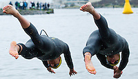 28 APR 2012 - LES SABLES D'OLONNE, FRA - Competitors dive into the water at the start of the swim at the men's French Grand Prix Series triathlon prologue round in Les Sables d'Olonne, France .(PHOTO (C) 2012 NIGEL FARROW)