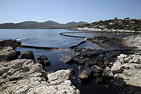 """Pictured: A floating barrier used to contain the oil spill that has reached the coast of Salamina, Greece<br />Re: An oil spill off Salamina island's eastern coast is spreading and has become """"an environmental disaster"""" according to local authorities in Greece.<br />The spill was caused by the sinking of the Aghia Zoni II tanker, carrying 2,200 metric tons of fuel oil and 370 metric tons of marine gas oil on Saturday, southwest of the islet of Atalanti near Psytalleia. According to reports, the coastline stretching from Kinosoura to the Selinia community has """"turned black"""" and authorities fear a new leak from the sunken ship.<br />According to the island's mayor, Isidora Papathanasiou, the weather """"turned on Sunday afternoon and brought the oil spill to Salamina."""""""