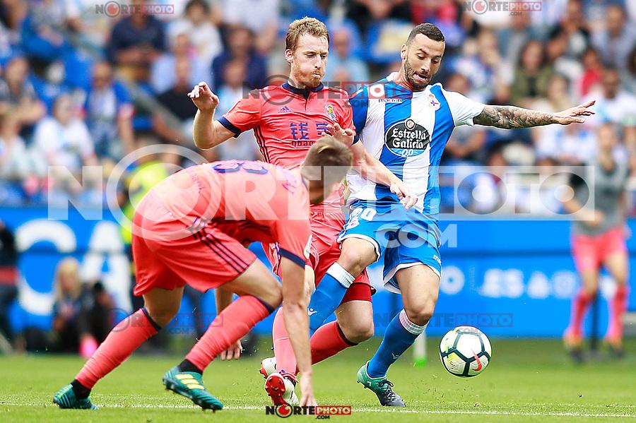 Deportivo de la Coruna's Guilherme Dos Santos (r) and Real Sociedad's Adnan Januzaj (l) and David Zurutuza during La Liga match. September 10,2017. (ALTERPHOTOS/Acero) /NortePhoto.com