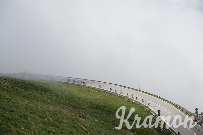 descending in/out of the mist from the highest point in the 2016 Tour; the Port d'Envalira (Cat1/2408m/22.6km at 5.5%)<br /> <br /> stage 10: Escaldes-Engordany (AND) - Revel (FR)<br /> 103rd Tour de France 2016