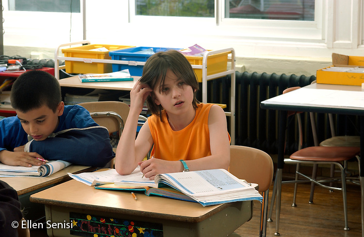 MR / Schenectady, NY / .Yates Arts in Education Magnet School / urban public elementary school / Grade 5.Girl (10, Japanese-American and Caucasian) listens during whole-class math lesson. .MR: AD-g5a Bar10..© Ellen B. Senisi