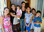 Zuhra Redjepi (second from left) with her children in the doorway of her house in Suto Orizari, the Macedonian municipality that is Europe's largest Roma settlement. The family survives from recycling.
