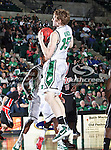 North Texas Mean Green center Ben Knox (15) grabs a rebound during the NCAA  basketball game between the Arkansas State Red Wolves and the University of North Texas Mean Green at the North Texas Coliseum,the Super Pit, in Denton, Texas. UNT defeated Arkansas State 83 to 64..
