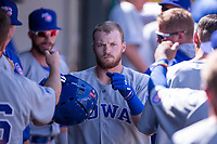 Ian Happ (8) of the Iowa Cubs celebrates in the dugout after hitting a home run in a game against the Oklahoma City Dodgers at Chickasaw Bricktown Ballpark on April 9, 2016 in Oklahoma City, Oklahoma.  Oklahoma City defeated Iowa 12-1 (William Purnell/Four Seam Images)