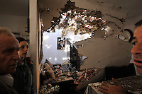 Residents in a house that was hit by a Palestinian rocket, shot by Hamas militants from neighbouring Gaza. Israeli forces began an air offensive against Hamas in the Gaza Strip on 27/12/2008, which quickly escalated into an offensive by land, sea and air, in retaliation against Palestinian rockets fired into Israel. After eight days of bombardment, leaving over 400 Palestinians and four Israelis dead, Israeli tanks entered Gaza on 04/01/2009...