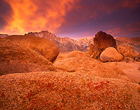 Alabama Hills Recreation Area and Mount Whitney of Sierra Nevada in background, with dramatic clouds at sunrise, California, USA