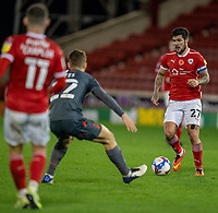 21st November 2020, Oakwell Stadium, Barnsley, Yorkshire, England; English Football League Championship Football, Barnsley FC versus Nottingham Forest; Alex Mowatt of Barnsley on the ball as Ryan Yates of Nottingham Forrest jockeys