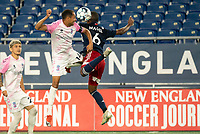FOXBOROUGH, MA - SEPTEMBER 04: Jamael Cox #14 Forward Madison FC and Maciel #6 of New England Revolution II leap to compete for a high ball during a game between Forward Madison FC and New England Revolution II at Gillette Stadium on September 04, 2020 in Foxborough, Massachusetts.