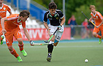 GER - Mannheim, Germany, May 16: During the whitsun tournament boys hockey match between Germany (black) and The Netherlands (orange) on May 16, 2016 at Mannheimer HC in Mannheim, Germany. Final score 4-3 (HT 2-0). (Photo by Dirk Markgraf / www.265-images.com) *** Local caption *** Joost van Eijck #15 of The Netherlands, Marinus Mack #26 of Germany (U16)