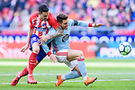 Victor Machin, Vitolo, of Atletico de Madrid (L) fights for the ball with Hugo Mallo Novegil of RC Celta de Vigo (R) during the La Liga 2017-18 match between Atletico de Madrid and RC Celta de Vigo at Wanda Metropolitano on March 11 2018 in Madrid, Spain. Photo by Diego Souto / Power Sport Images
