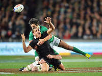 Israel Dagg loses the ball in the tackle during the Steinlager Series international rugby test match between All Blacks and Ireland at Eden Park, Auckland, New Zealand on Saturday, 9 June 2012. Photo: Dave Lintott / lintottphoto.co.nz