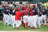 Clearwater Threshers Drew Stankiewicz (15) Is mobbed by teammates after the second round of the home derby before the Florida State League All-Star Game on June 17, 2017 at Joker Marchant Stadium in Lakeland, Florida.  Teammates include Cavan Biggio, Gavin LaValley, Chris Okey, Shed Long, Austin Riley, Jose Taveras, Jorge Mateo, and Cole Irvin (L-R).  FSL North All-Stars  defeated the FSL South All-Stars  5-2.  (Mike Janes/Four Seam Images)
