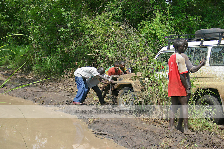 The South Sudanese road leading from Rumbek south to Uganda bears spots of deep mud at various points along the way.  An NGO vehicle is stuck for hours.