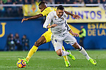 Cédric Bakambu (l) of Villarreal CF fights for the ball with  Carlos Henrique Casemiro of Real Madrid during their La Liga match between Villarreal CF and Real Madrid at the Estadio de la Cerámica on 26 February 2017 in Villarreal, Spain. Photo by Maria Jose Segovia Carmona / Power Sport Images