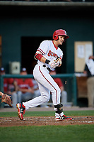 Harrisburg Senators left fielder Alec Keller (34) hits a single and breaks his bat during a game against the Erie SeaWolves on August 29, 2018 at FNB Field in Harrisburg, Pennsylvania.  Harrisburg defeated Erie 5-4.  (Mike Janes/Four Seam Images)