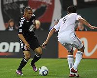 DC United forward Charlie Davies (9) goes against Los Angeles Galaxy defender Omar Gonzalez (4).  DC United tied Los Angeles Galaxy 1-1, at RFK Stadium, Saturday April 9, 2011.