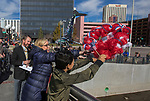 Ten-year old Messiah helps Reno Mayor Hillary Schieve toss a wreath into the Truckee River before the start of the Veterans Day Parade in downtown Reno on Saturday, Nov. 11, 2017.