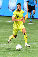 ATLANTA, GA - AUGUST 22: Daniel Lovitz #2 dribbles the ball during a game between Nashville SC and Atlanta United FC at Mercedes-Benz Stadium on August 22, 2020 in Atlanta, Georgia.