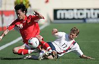 USA's Jonathan Spector tackles China's Wang Dong. USA defeated China, 4-1, at Spartan Stadium in San Jose, Calif., on June 2, 2007.